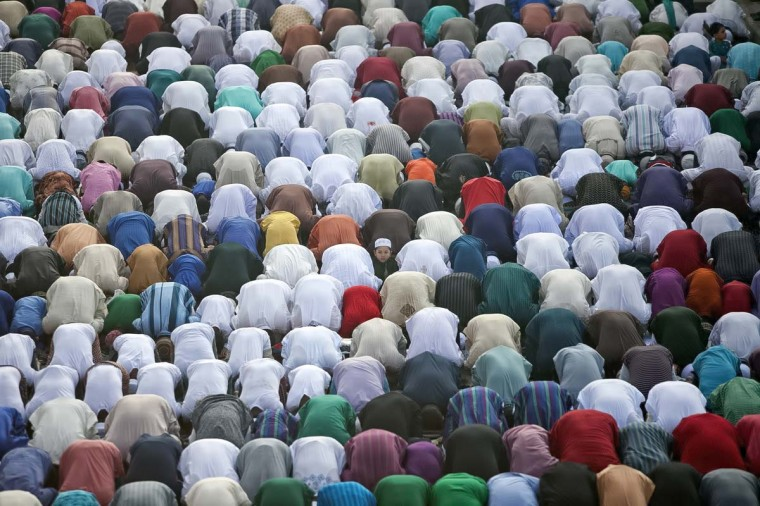 People attend prayer outside the National Mosque during the Eid-al-Adha holiday October 6, 2014 in Dhaka, Bangladesh. Eid Al-Adha, known as the 'Feast of the Sacrifice', is one of the most significant festivals on the Muslim calendar and lasts for four days. The holiday marks the end of the Haji Pilgrimage and serves as a day to remember the Islamic profit Ibrahim, and his willingness to sacrifice of his son, Ismail (Ishmael) as an act of submission to Allah, before Allah intervened and gave Ibrahim a lamb to slaughter in the place of his son. On this day, Muslims in countries around the world start the day with prayer and spend time with family, offer gifts and often give to charity. It is customary for Muslim families to honour Allah by sacrificing a sheep or goat and sharing the meat amongst family members. (Allison Joyce/Getty Images)