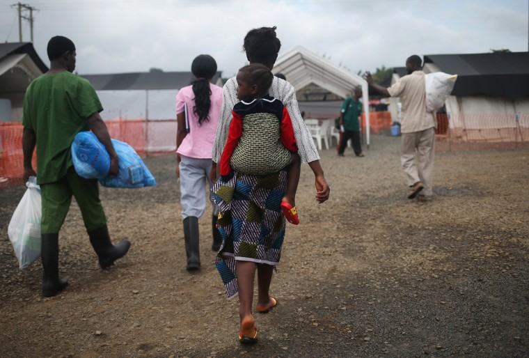 Ebola survivors prepare to leave the Doctors Withouth Borders (MSF), treatment center after recovering from the virus on October 12, 2014 in Paynesville, Liberia. About 40 percent of people who contract the disease survive. According to the World Health Organization, the Ebola epidemic has killed more than 4,000 people in West Africa. (Photo by John Moore/Getty Images)