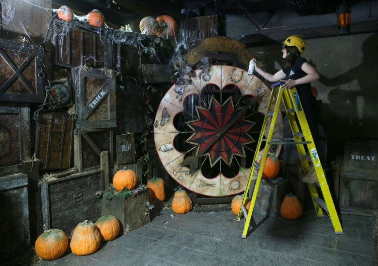 Natalie Cartwright makes finishing touches to the Master of Tricks' Halloween wheel of misfortune at the London Dungeon, where the season of scare will run until Wednesday, November 5 at The London Dungeon. (Danny E. Martindale/Getty Images)