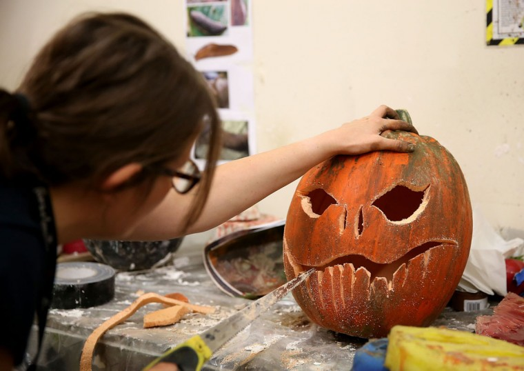 Natalie Cartwright carves one of the 1600 pumpkins that have been installed into the London Dungeon this Halloween, where the season of scare will run until Wednesday, November 5 at The London Dungeon. (Danny E. Martindale/Getty Images)
