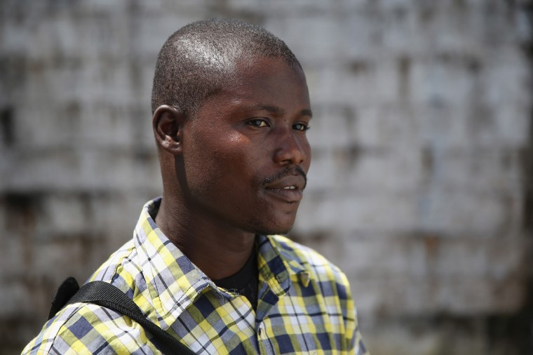 Moses Lansanah, 30, stands at the Doctors Without Borders (MSF), Ebola treatment center after meeting with fellow survivors on October 16, 2014 in Paynesville, Liberia. Lansanah, a construction worker, said he lost his pregnant fiance, Amifete, 22, who was 9 months pregnant with his child, when she died of Ebola. The disease has a 70 percent mortality rate, according to the World Health Organization, but leaves survivors immune to the strain that sickened them. (Photo by John Moore/Getty Images)