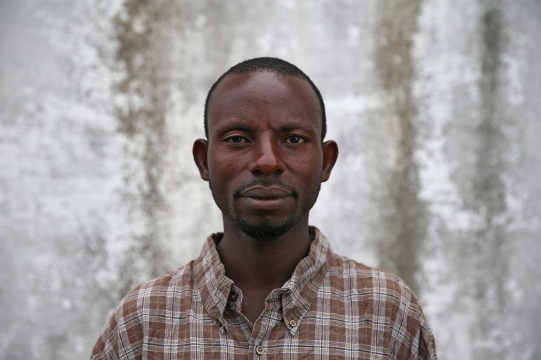 Ebola survivor Paul Horace, 34, stands outside the JFK Ebola treatment center after recovering from the disease on October 13, 2014 in Monrovia, Liberia. Horace, an ambulance driver, spent a week at there recovering from the disease, which has an average 70 percent mortality rate. Ebola leaves survivors immune to the strain that sicked them. (Photo by John Moore/Getty Images)