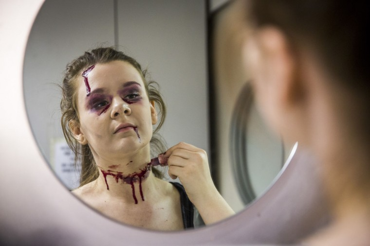 Katy Kennedy, an employee of Angels Fancy Dress, applies fake blood to her halloween costume on October 31, 2014 in London, England. Angels, the worlds largest fancy dress retailer, was founded in 1840 and has supplied costumes to numerous film and television productions as well as to the general public. The week leading up to Halloween is traditionally one of the stores busiest times of the year. ( Rob Stothard/Getty Images)