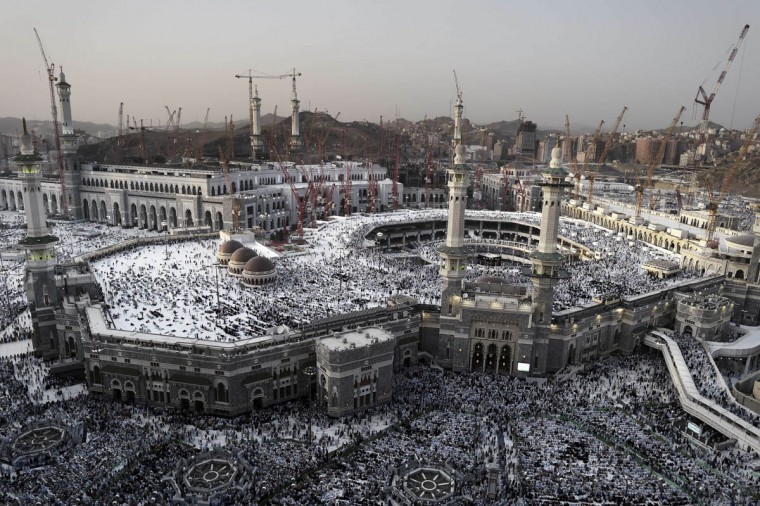 "This general view shows Muslim pilgrims arriving for a prayer at Mecca's Grand Mosque, home of the cube-shaped Kaaba or ""House of God"" that Muslims believe was built by Abraham 4,000 years ago. Hundreds of thousands of Muslim worshipers started pouring into the holy city for the annual Hajj pilgrimage. This year's Hajj comes as the authorities strive to protect pilgrims from two deadly viruses, Ebola and Middle East Respiratory Syndrome coronavirus or MERS. (Mohammed Al-Shaikh/Getty Images)"