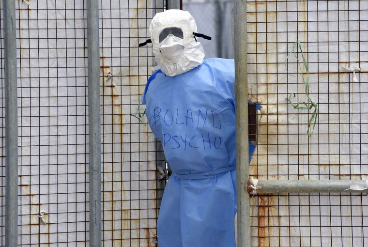 A health worker in protective suit stands at Island Hospital in Monrovia. Liberia has been hit the hardest by the worst-ever outbreak of Ebola, which has killed more than 3,000 people in west Africa. The latest UN data released Saturday said 1,830 people have died from the killer virus in Liberia so far, and 3,458 people have been infected. (Pascal Guyot/Getty Images)