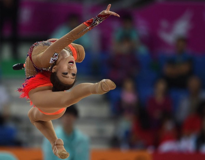 South Korea's Lee Nakyung performs during the women's rythmic gymnastics team event of the 2014 Asian Games at the Seonhak Gymnasium in Incheon. (Indranil Mukhrjee/Getty Images)