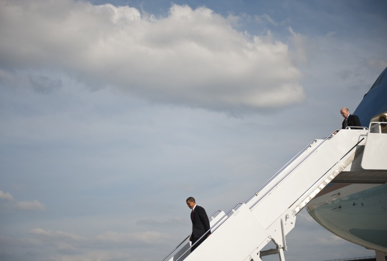 This June 5, 2009, file photo shows US President Barack Obama walking down the steps of Air Force One trailed US Secret Service agent Joseph Clancy (R) at Ramstein Air Base in Germany. Clancy, former director of the service's Presidential Protective Division (PPD), has been named acting director of the US Secret Service, a day after Direcor Julia Pierson stepped down from the post. Pierson resigned on October 1, 2014, after a series of security lapses at the White House involving the agency. (Mandel Ngan/AFP/Getty Images)