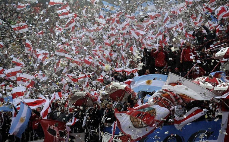 Supporters of River Plate cheer for their team before their Argentine First Division football match against Boca Juniors, at the Monumental stadium in Buenos Aires, Argentina, on October 5, 2014. (Alejandro Pagni/AFP/Getty Images)