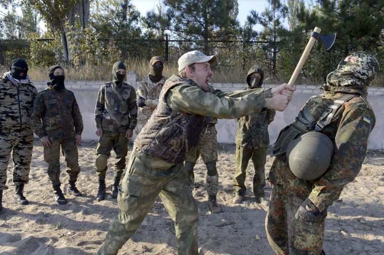 Servicemen of the pro-Ukrainian St. Maria battalion take part in military exercises near the eastern Ukrainian city of Mariupol on October 6, 2014. The first European drones landed in Ukraine and a top US envoy visited Kiev in an urgent bid to bolster its crumbling truce with pro-Russian fighters. Ukraine also announced the arrival of German winter supplies for towns and cities devastated by nearly six months of warfare that has killed nearly 3,300 people across the separatist east. (Alexander Khudoteply/AFP/Getty Images)