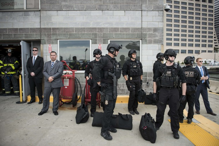Members of a US Secret Service counter assault team wait for the arrival of US President Barack Obama at the Wall Street Heliport, October 7, 2014 in New York. Obama is traveling to New York and Connecticut to attend fund raisers for Democrats. (Brendan Smialowski/AFP/Getty Images)