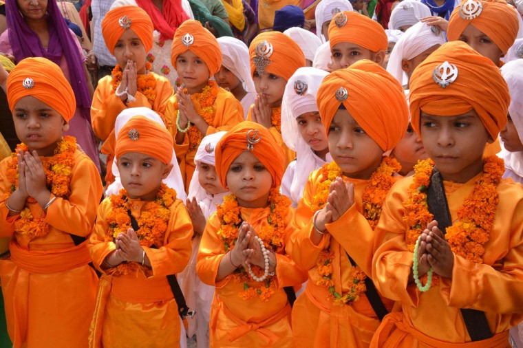 Indian Sikh school children dressed as Punj Pyara participate in a procession from the Sri Akal Takhat at the Sikh Shrine, The Golden Temple in Amritsar on October 8, 2014, on the eve of the birth anniversary of the fourth Sikh Guru Ramdass. Ramdass was born in Lahore in 1574 and is Chauthi Patshahi or the fourth Guru as well as the Guru who established the city of Amritsar. (Narinder Nanu/Getty Images)