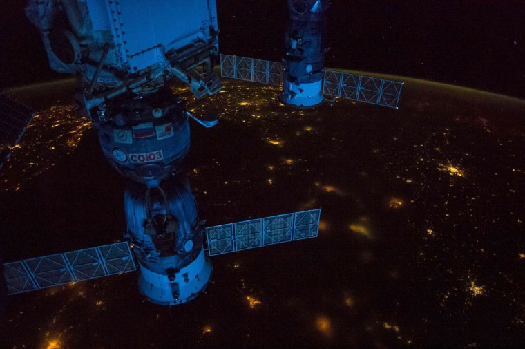This NASA handout photo taken by Expedition 41 crew members aboard the International Space Station (ISS), flying at an altitude of 220 nautical miles, photographed this night panorama of parts of Europe. Kiev, Ukraine is seen near the right edge of the photo in the center. Lights of Constanta, Romania can be seen just below the Russian Progress 56 cargo vehicle docked to the orbital outpost at the top of the frame. The Black Sea is to the left of the Soyuz TMA-13M docked to the station on the left side of the scene. Krasnodar, Russia is in the bottom left corner. Part of Greece is in the top of the image near the solar panel of the Progress. Part of Turkey is in upper left of the land mass visible. Pre-dawn light coming through the atmosphere gives the station hardware a bluish color. (NASA /Getty Images)