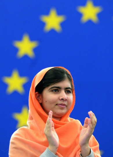 Malala Yousafzai, a Pakistani student who was shot in the head by the Pakistani Taliban applauds a speech after being awarded with the Sakharov Prize for Freedom of Thought at the European Parliament in Strasbourg, eastern France. The Nobel Peace Prize went October 10, 2014 to 17-year-old Pakistani Malala Yousafzai and India's Kailash Satyarthi for their work promoting children's rights. (Patrick Hertzog/AFP/Getty Images)