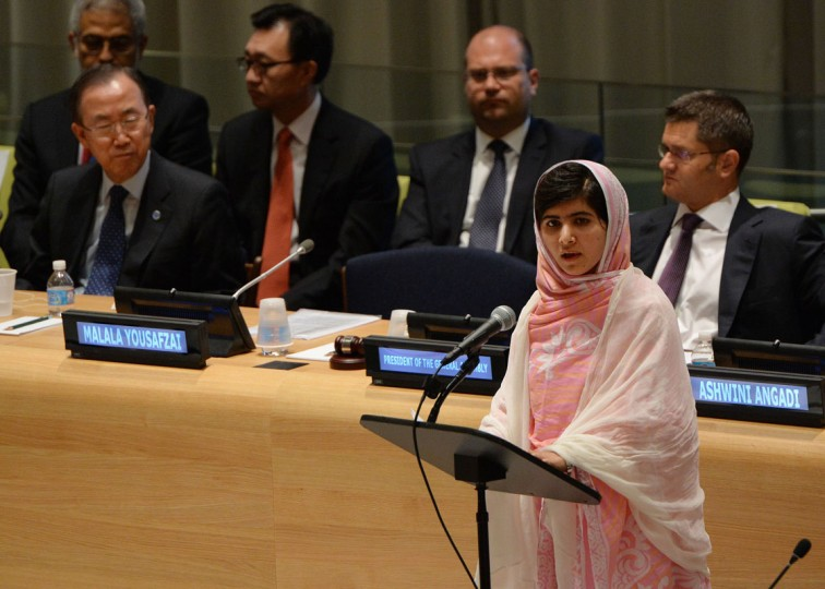 Pakistani student Malala Yousafzai speaks before the United Nations Youth Assembly at UN headquarters in New York as UN Secretary General Ban Ki-Moon (L) and Vuk Jeremic (R), President of the UN General Assembly listen. The Nobel Peace Prize went October 10, 2014 to 17-year-old Pakistani Malala Yousafzai and India's Kailash Satyarthi for their work promoting children's rights. (Stan Honda/AFP/Getty Images)