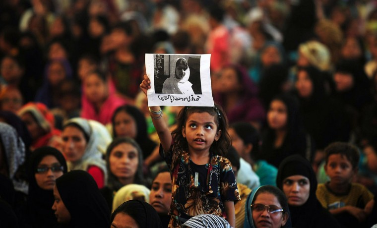 Pakistani female supporter of Muttahida Quami Movement (MQM) carries a photograph of gunshot victim, Malala Yousafzai as she prays for the recovery of Malala Yousafzai, in Karachi on October 10, 2012. The Nobel Peace Prize went October 10, 2014 to 17-year-old Pakistani Malala Yousafzai and India's Kailash Satyarthi for their work promoting children's rights. (Rizwan Tabassum/AFP/Getty Images)
