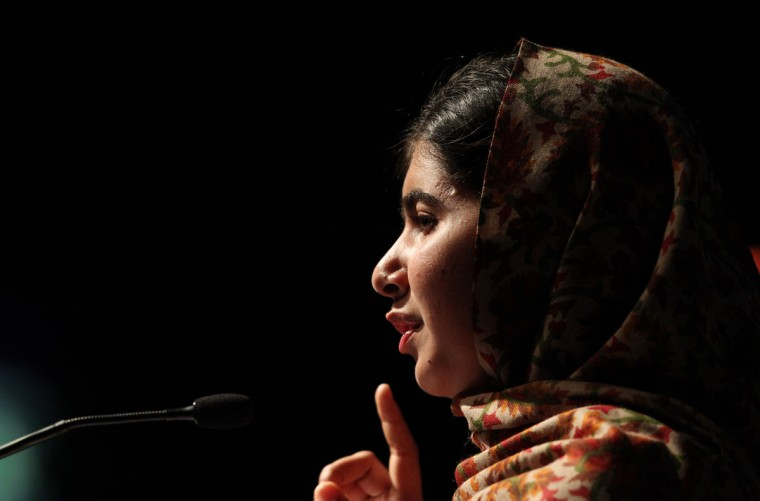 Pakistani student who was shot in the head by the Pakistani Taliban, Malala Yousafzai addresses the assembly before receiving the Amnesty International Ambassador of Conscience Award for 2013 at the Manison House in Dublin, Ireland. The Nobel Peace Prize went October 10, 2014 to 17-year-old Pakistani Malala Yousafzai and India's Kailash Satyarthi for their work promoting children's rights. (Peter Muhly/AFP/Getty Images)
