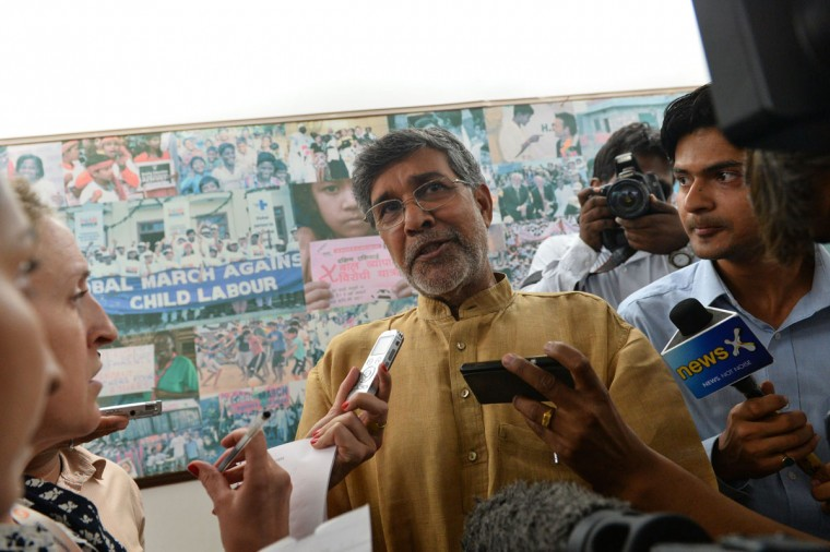 Indian activist Kailash Satyarthi talks to journalists at this home office after the announcement of him receiving the Nobel Peace Prize, in New Delhi on October 10, 2014. Indian activist Kailash Satyarthi said October 10 his Nobel Peace Prize would help highlight the plight of children around the world, and invited fellow winner Malala Yousafzai to work with him. (Chandan Khanna/AFP/Getty Images)