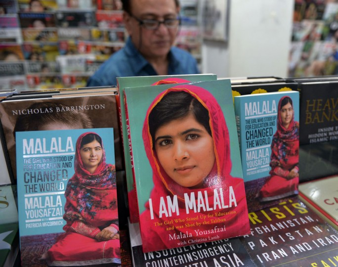 "Autobiographies of Malala Yousafzai are displayed at a bookstore in Islamabad on October 10, 2014. Malala Yousafzai was hailed as the ""pride of Pakistan"" by Prime Minister Nawaz Sharif for winning the Nobel Peace Prize, as a former fellow pupil said the award was a victory for every girl in the country. Political leaders and activists alike rallied around Malala, the youngest ever Nobel laureate, expressing their support for the education campaigner who moved to Great Britain after being shot in the head by Taliban militants two years ago. (Qureshia Amir/AFP/Getty Images)"