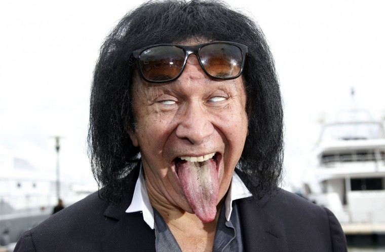 "Israeli-US actor and musician, member of the band Kiss, Gene Simmons sticks his tongue out as he poses during a photocall for the TV series ""Gene Simmons"" as part of the MIPCOM, on October 14, 2014 in Cannes, southeastern France. (VALERY HACHE/AFP/Getty Images)"