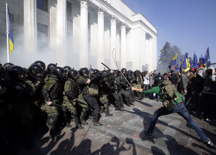 Ukrainian supporters and activists of far-right parties and nationalist movements clash with riot police outside the Ukrainian parliament in Kiev on October 14, 2014. (ANATOLII STEPANOV/AFP/Getty Images)Ukrainian supporters and activists of far-right parties and nationalist movements clash with riot police outside the Ukrainian parliament in Kiev on October 14, 2014. (ANATOLII STEPANOV/AFP/Getty Images)