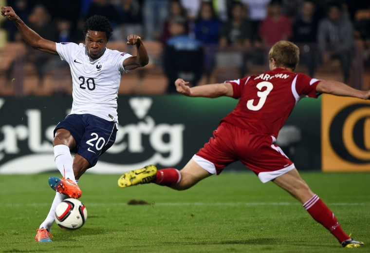 France's Loic Remy (left) challenges Armenia's Varazdat Haroyan during a friendly soccer match between Armenia and France at the Republican Stadium in Yerevan on October 14, 2014. (FRANCK FIFE/AFP/Getty Images)