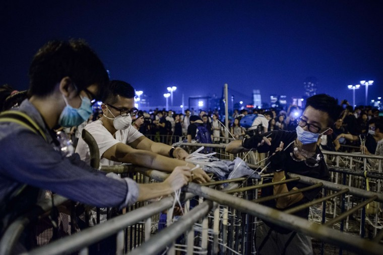 Pro-democracy protesters set up a barricade following a standoff with police outside the central government offices in Hong Kong on October 14, 2014. (PHILIPPE LOPEZ/AFP/Getty Images)