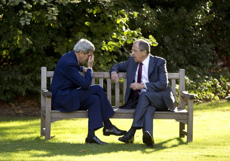 US Secretary of State John Kerry (left) speaks with Russian Foreign Minister Sergei Lavrov at the Chief of Mission Residence in Paris on October 14, 2014. (Carolyn Kaster/AFP/Getty Images)