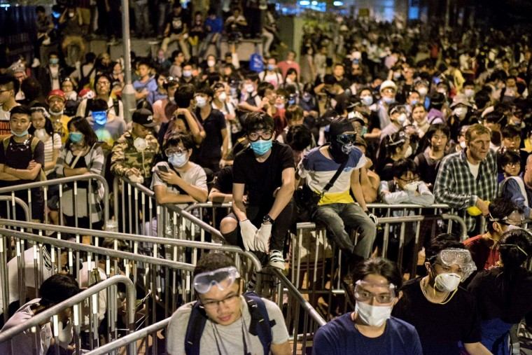 Pro-democracy protesters gather near the central government offices in Hong Kong on October 15, 2014. Hong Kong has been plunged into the worst political crisis since its 1997 handover as pro-democracy activists take over the streets following China's refusal to grant citizens full universal suffrage. AFP PHOTO/Getty Images/Alex Ogle)
