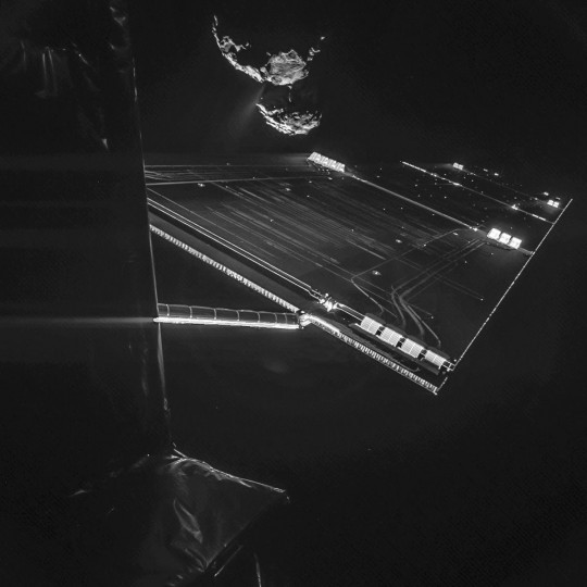 A handout photo released on October 15, 2014 by the European Space Agency shows a picture taken with the CIVA camera on Rosettas Philae lander showing comet 67P/ChuryumovGerasimenko from a distance of about 16 km from the surface of the comet. The 'selfie' image was taken on October 7, 2014 and captures the side of the Rosetta spacecraft and one of Rosettas 14 m-long solar wings, with the comet in the background. Two images with different exposure times were combined to bring out the faint details in this very high contrast situation. The comet's active neck region is clearly visible, with streams of dust and gas extending away from the surface. (AFP PHOTO / ESA/Rosetta/Philae/CIVA)