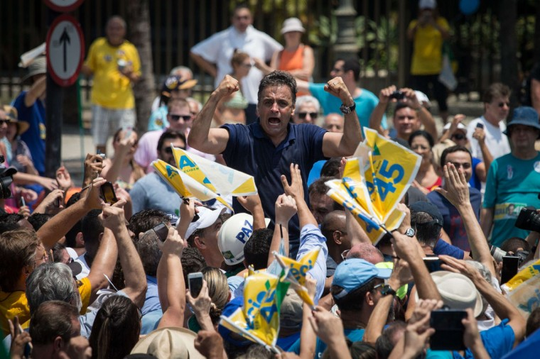 Brazilian presidential candidate for the Brazilian Social Democracy Party (PSDB), Aecio Neves, gestures at supporters during his campaign at Copacabana beach in Rio de Janeiro, Brazil, on October 19, 2014. (YASUYOSHI CHIBA/AFP/Getty Images)