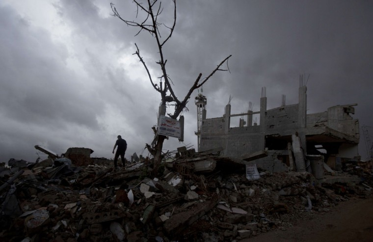 A Palestinian man walks through a neighborhood destroyed during the 50-day conflict between Israel and Hamas, in the Shejaiya neighborhood of Gaza City on October 19, 2014. (MAHMUD HAMS/AFP/Getty Images)