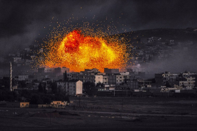Smoke and flames rise following an explosion in the Syrian town of Kobane, also known as Ain al-Arab, as seen from the southeastern Turkish village of Mursitpinar in the Sanliurfa province on October 20, 2014. (BULENT KILIC/AFP/Getty Images)