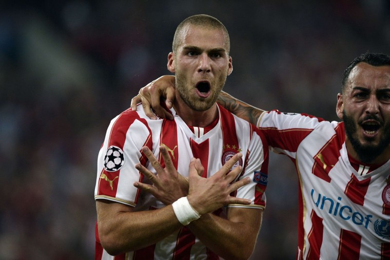 Pajtim Kasami celebrates after scoring a goal during the Group A Champions League football match Olympiacos vs. Juventus at the Karaiskaki stadium in Athens' Piraeus district on October 22, 2014. (LOUISA GOULIAMAKI/AFP/Getty Images)