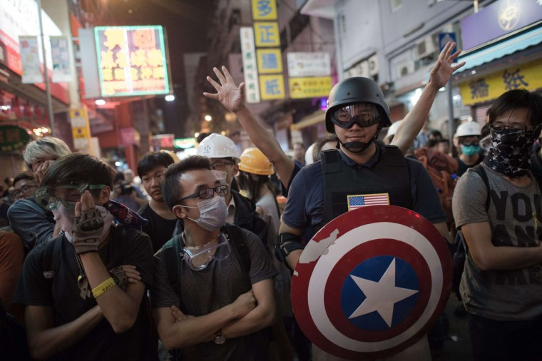 Pro-democracy protesters stand their ground on a barricaded road in the Mongkok district of Hong Kong on October 23, 2014. (NICOLAS ASFOURI/AFP/Getty Images)