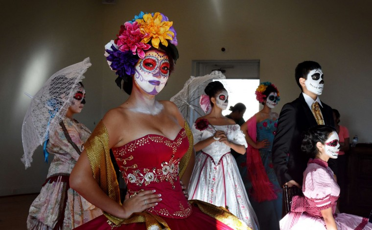 Mexican Damas rehearse in their costumes for the upcoming festival of Dia de los Muertos at the Hollywood Forever Cemetery in Los Angeles, California on October 24, 2014. The Mexican festival celebrated on November 1, is held to remember friends and family members who have died and dates back to an ancient Aztec festival dedicated to the goddess Mictecacihuatl. (Mark Ralston/AFP/Getty Images)