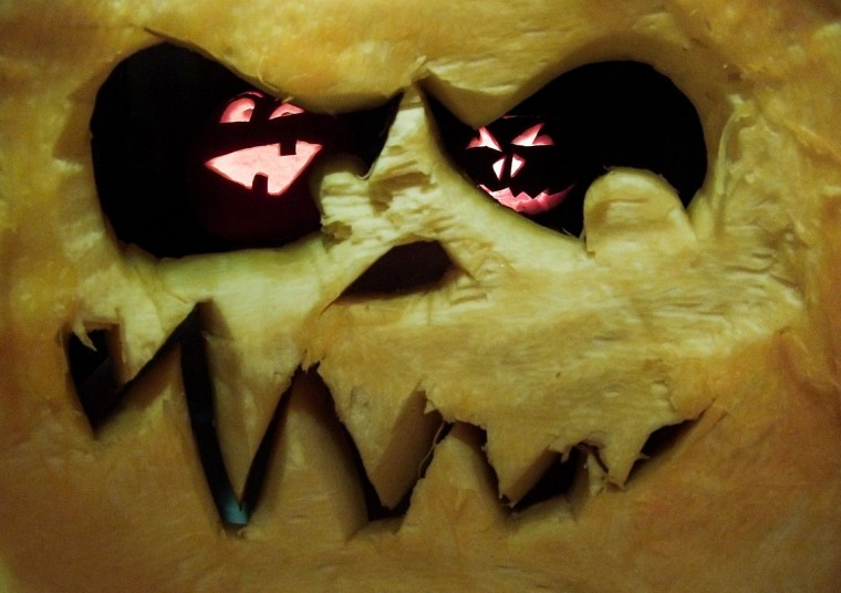 Pumpkins carved as grimacing faces are pictured on October 28, 2014 in Hanover, central Germany, days before Halloween. (Ole Spata/AFP/Getty Images)