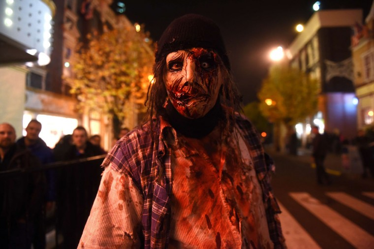 "Actors dressed up as horror movie characters scare visitors the day before halloween at the ""Warner Movie Park"" in Bottrop, western Germany on October 30, 2014. (Patrik Stollarz/AFP/Getty Images)"