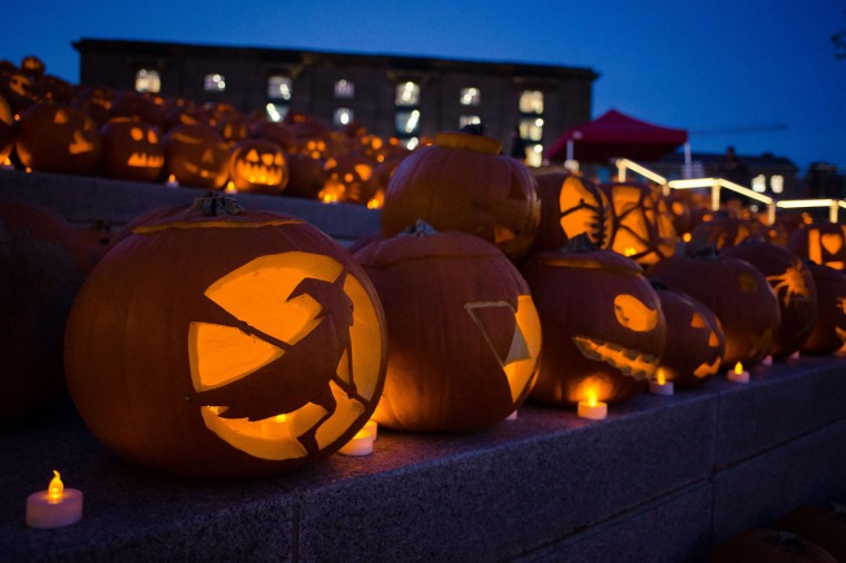 A display of carved Halloween pumpkins is seen at Granary Square in London on October 31, 2014. Halloween is an annual celebration that uses humor and ridicule to confront death. Typical festive Halloween activities include trick-or-treating, attending costume parties and carving pumpkins into jack-o'-lanterns. (Leon Neal/AFP/Getty Images)
