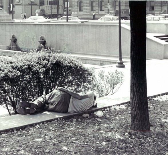 Ninety degree temperature provided this City Hall Plaza man an excuse to stretch out. (Baltimore Sun/Sept. 14, 1961)