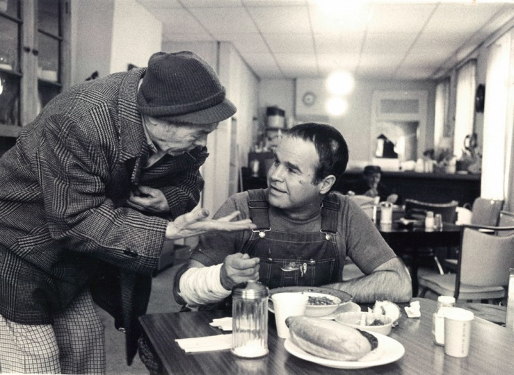Don Dillow, a bandage covering a burn on his right arm, talks to a friend in beans & Bread, an Aliceanna Street soup kitchen. (Baltimore Sun/April 1, 1979)