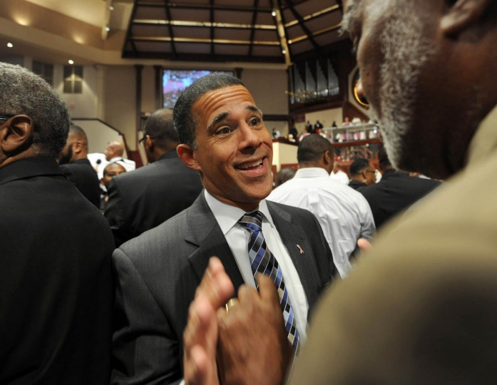 10/5/14: Lieutenant Governor Anthony Brown, center, is pictured during the 7:45 am service at Ebenezer AME Church with church member, Kemry Hughes when all men were called to the front of the altar. (Algerina Perna, Baltimore Sun)