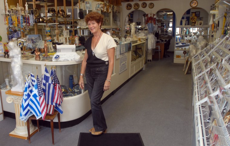 8/4/08: Nitsa Morekas, owner of Kentrikon, a Greek themed gift and music store, in her shop on Eastern Ave. (Barbara Haddock Taylor/The Baltimore Sun)