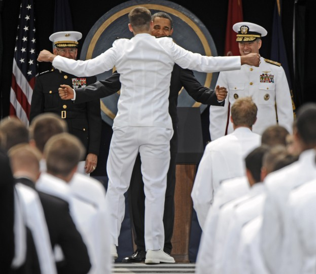 President Barack Obama gets a chest bump from a graduating Midshipman while giving out diplomas in in May 2009. The President gave the graduation address at the United States Naval Academy Graduation and Commissioning Ceremonies. (Kenneth K. Lam/Baltimore Sun)