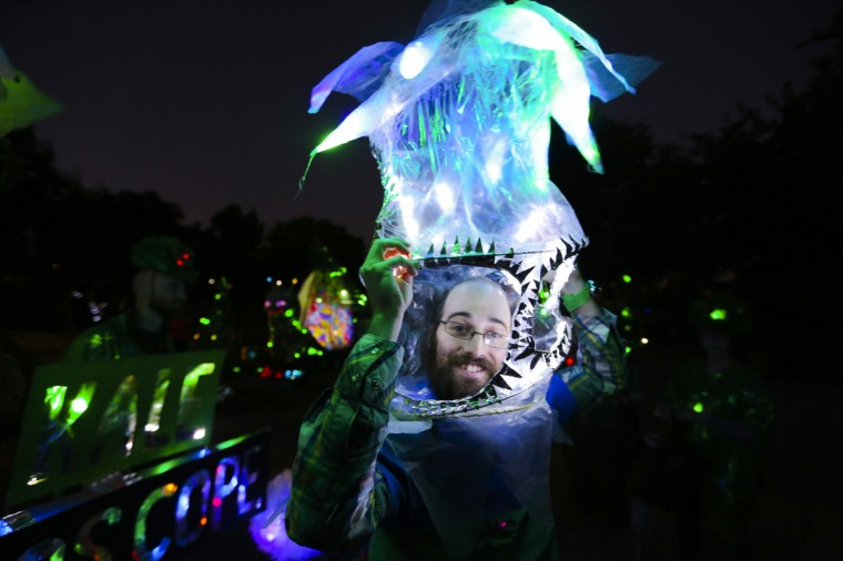 Sam Grossman, 24, shows off his lantern plant hat at the annual Halloween Lantern Parade at Patterson Park this past weekend. (Kaitlin Newman/Baltimore Sun)
