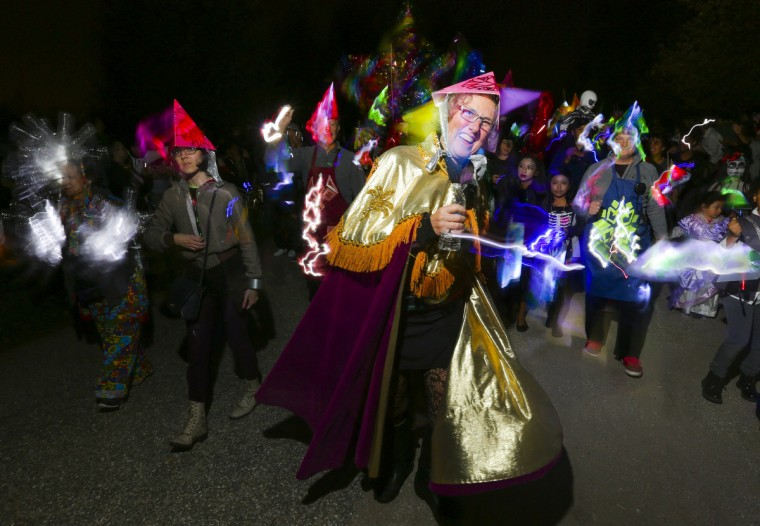 Megan Hamilton, co-founder and co-director of the Creative Alliance, leads the parade at the annual Halloween Lantern Parade at Patterson Park this past weekend. (Kaitlin Newman/Baltimore Sun)