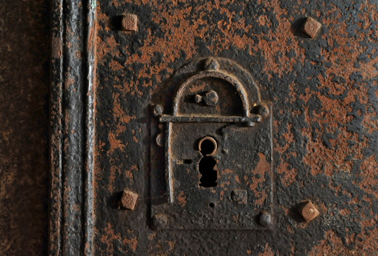 In the catacombs, a rusted lock shows the age of the McClellan vault, which contains the remains of 25 members of the McClellan, Raborg and Wagner families. Samuel McClellan was a Baltimore merchant who served on the Baltimore City Council and was a veteran of the War of 1812. Amy Davis / Baltimore Sun