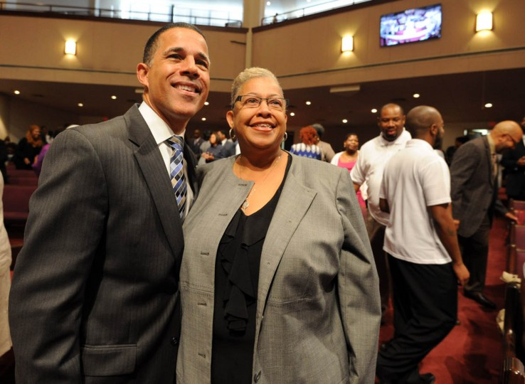 10/5/14: Lieutenant Governor Anthony Brown, left, is pictured with Bessie A. Martin at the 7:45 am service at Ebenezer AME Church. (Algerina Perna, Baltimore Sun)