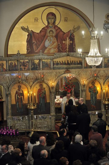 """4/14/12: Fr. Michael Pastrikos gives Communion as he leads Great Vespers and the Liturgy of St. Basil, """"The First Liturgy of the Resurrection"""" on Holy Saturday Morning at St. Nicholas Greek Orthodox Church. (Kim Hairston/Baltimore Sun)"""