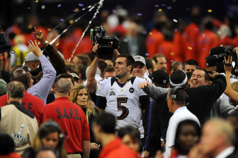 Joe Flacco is surrounded after the end of the Ravens' Super Bowl win over the 49ers. (Kenneth K. Lam/Baltimore Sun)
