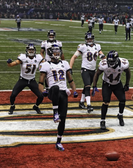 Jacoby Jones celebrates with teammates in the end zone after a record-setting 108-yard kickoff return for a touchdown to open the second half of the Ravens-49ers Super Bowl. (Kenneth K. Lam/Baltimore Sun)